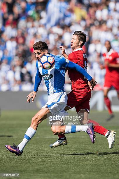 Carl Medjani of Deportivo Leganes fights for the ball with Luciano Vietto of Sevilla FC during their La Liga match between Deportivo Leganes and...