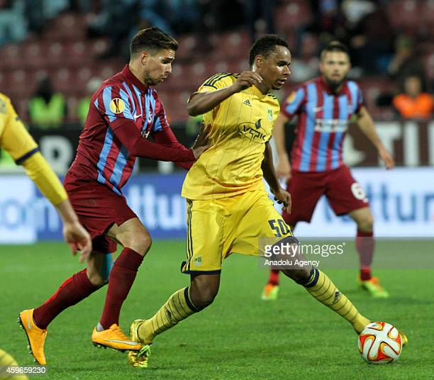 Carl Medjani of Trabzonspor in action against Jaja of Metalist Kharkiv during the UEFA Europa League Group L football match Trabzonspor vs Metalist...