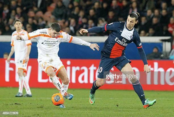 Carl Medjani of Valenciennes VAFC and Zlatan Ibrahimovic of Paris Saint-Germain in action during the French Ligue 1 between Paris Saint-Germain FC...