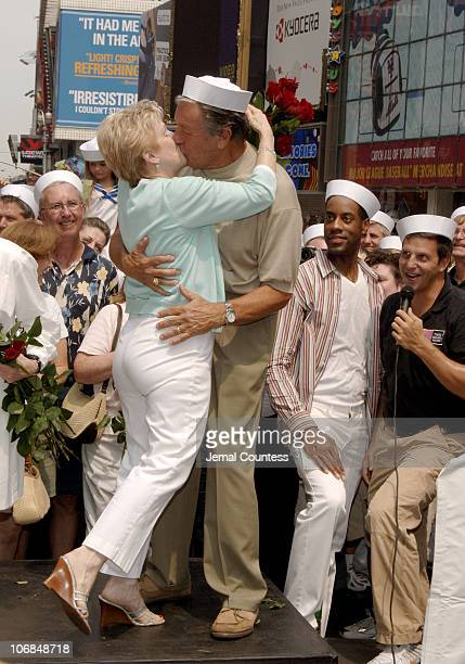 Carl Muscarello kisses his wife during the reenactment of the famous kiss captured by Alfred Eisenstaedt in Times Square in New York City on August...