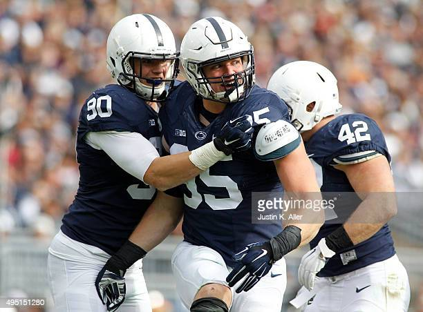 Carl Nassib of the Penn State Nittany Lions celebrates with Garrett Sickels after a sack in the second half during the game against the Illinois...