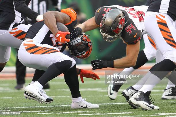 Carl Nassib of the Tampa Bay Buccaneers attempts to tackle Joe Mixon of the Cincinnati Bengals during the first quarter of the game at Paul Brown...