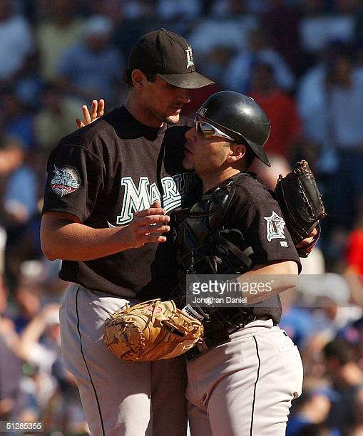 Carl Pavano of the Florida Marlins is hugged by teammate Paul Lo Duca after throwing a complete game shutout against the Chicago Cubs during game one...