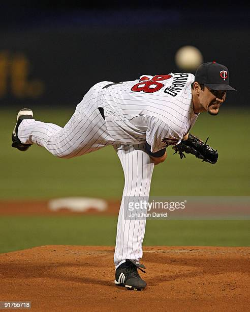 Carl Pavano of the Minnesota Twins delivers the ball against the New York Yankees in Game Three of the ALDS during the 2009 MLB Playoffs at the...