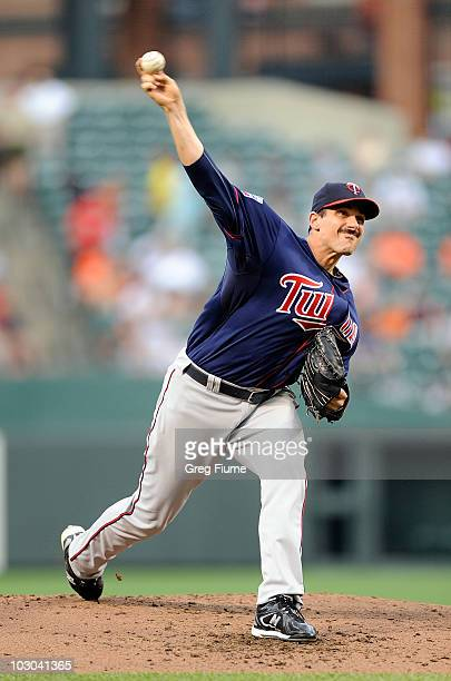 Carl Pavano of the Minnesota Twins pitches against the Baltimore Orioles at Camden Yards on July 22 2010 in Baltimore Maryland