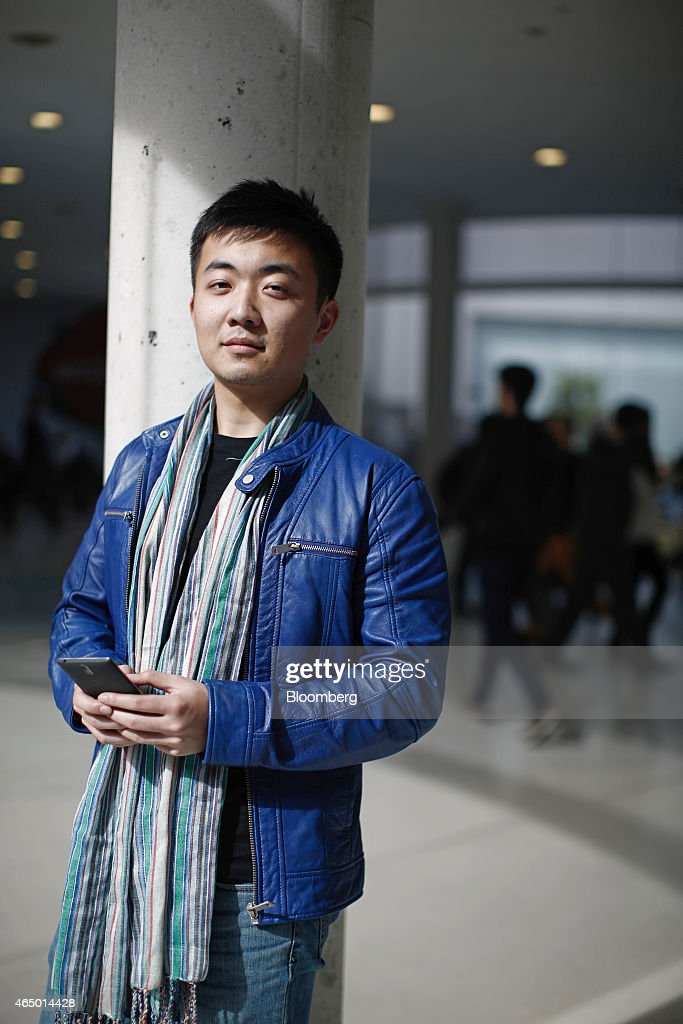 Carl Pei, co-founder of OnePlus, poses for a photograph with a OnePlus One smartphone at the Mobile World Congress in Barcelona, Spain, on Monday, March 2, 2015. The event, which generates several hundred million euros in revenue for the city of Barcelona each year, also means the world for a week turns its attention back to Europe for the latest in technology, despite a lagging ecosystem. Photographer: Simon Dawson/Bloomberg via Getty Images