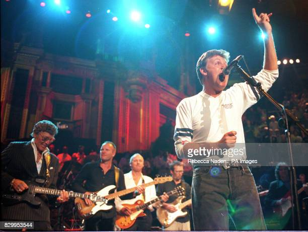 Carl Perkins Sting Mark Knopfler and Eric Clapton paly guitar while Sir Paul McCartney sings during the finale of the Music for Montserrat benefit...