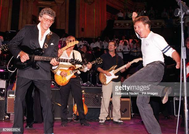Carl Perkins who died on 15/9/97 after suffering 3 strokes Mark Knopfler Eric Clapton and Sir Paul McCartney perform during the finale of the Music...