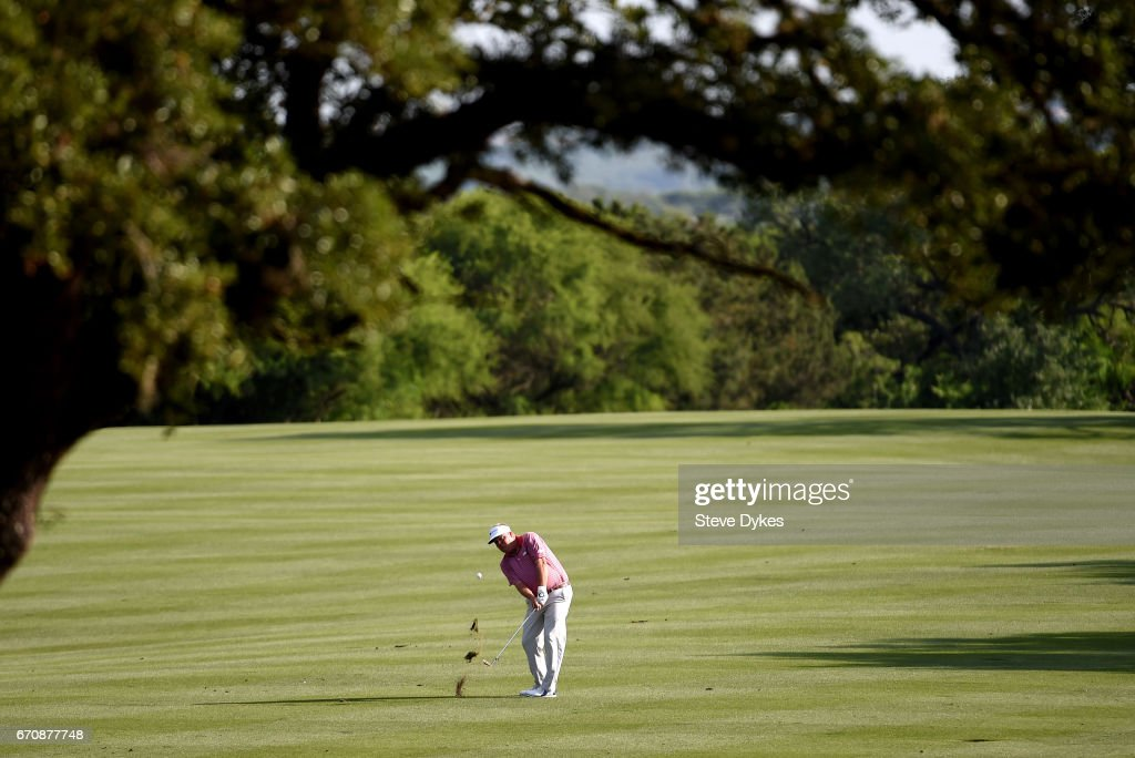 Carl Petterson of Sweden plays his shot on the eighth hole during the first round of the Valero Texas Open at TPC San Antonio AT&T Oaks Course on April 20, 2017 in San Antonio, Texas.
