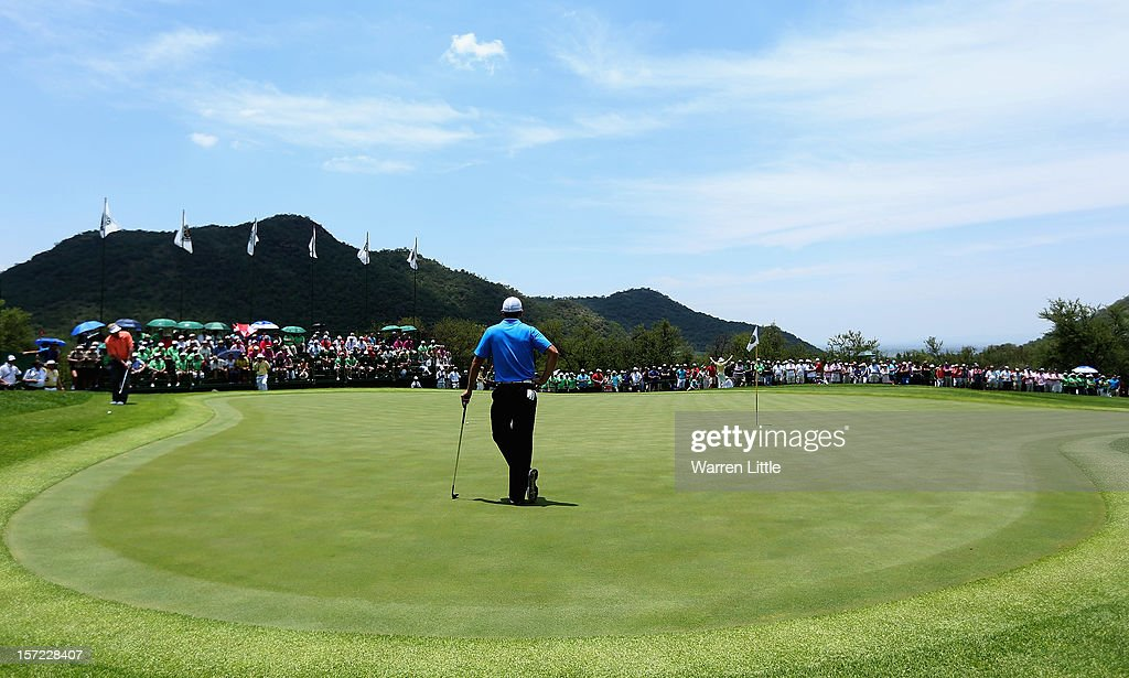 Carl Pettersson of Sweden is watched by Charl Schwartzel of South Africa during the second round of the Nedbank Golf Challenge at the Gary Player Country Club on November 30, 2012 in Sun City, South Africa.