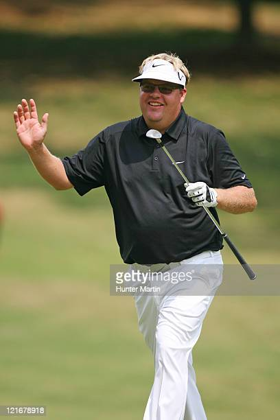 Carl Pettersson of Sweden waves to the crowd after making birdie on the first hole during the final round of the Wyndham Championship at Sedgefield...