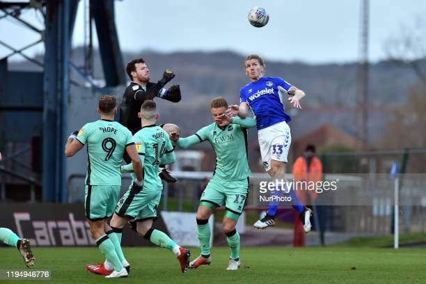 Carl Piergianni of Oldham Athletic and Adam Collin of Carlisle United in action during the Sky Bet League 2 match between Oldham Athletic and...