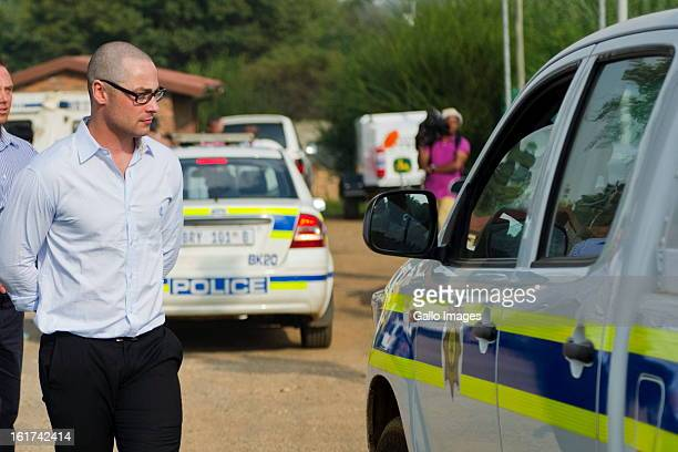 Carl Pistorius attends the Pretoria Magistrate court on February 15 in Pretoria South Africa Oscar Pistorius stands accused of murder after shooting...
