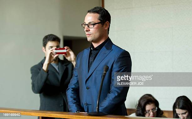 Carl Pistorius the brother of Oscar Pistorius waits prior to appear in court for culpable homicide of a 36yearold woman in a collision involving his...