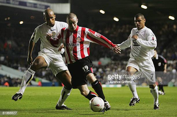 Carl Robinson of Sunderland breaks past Clarke Carlisle and Jermaine Wright of Leeds during the CocaCola Championship match between Leeds United and...