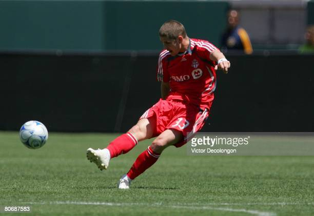 Carl Robinson of Toronto FC strikes the ball at midfield in the first half against the Los Angeles Galaxy during their MLS game at the Home Depot...