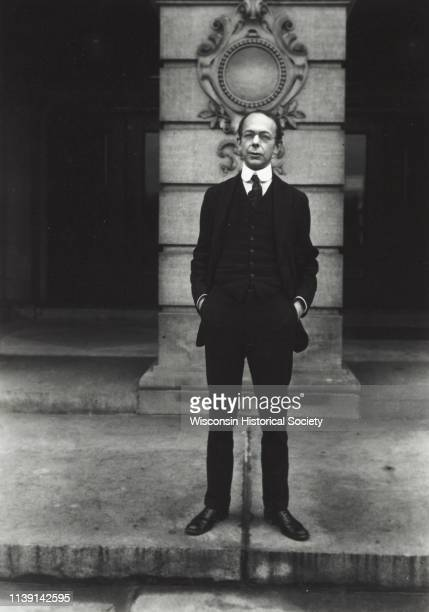 Carl Russell Fish noted professor of American history at the University of Wisconsin shown standing on the steps of the State Historical Society...