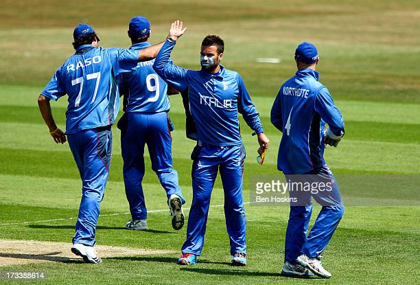 Carl Sandri of Italy celebrates with team mates after dismissing Benjamin Stevens of Jersey during the semi final match between Italy and Jersey at...