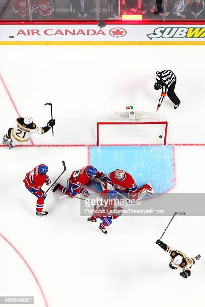 Carl Soderberg and Loui Eriksson of the Boston Bruins celebrate their overtime win against Carey Price Douglas Murray Mike Weaver and Lars Eller of...