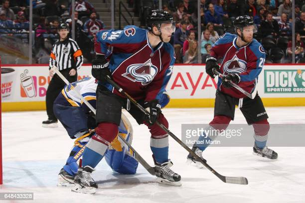 Carl Soderberg and Mikhail Grigorenko of the Colorado Avalanche stand in front of goaltender Jake Allen of the St Louis Blues at the Pepsi Center on...