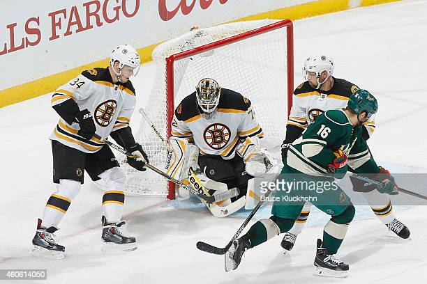 Carl Soderberg Niklas Svedberg and Dennis Seidenberg of the Boston Bruins defend their goal against Jason Zucker and the Minnesota Wild during the...