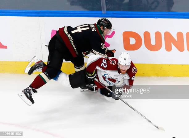 Carl Soderberg of the Arizona Coyotes checks Gabriel Landeskog of the Colorado Avalanche during the second period in Game Three of the Western...
