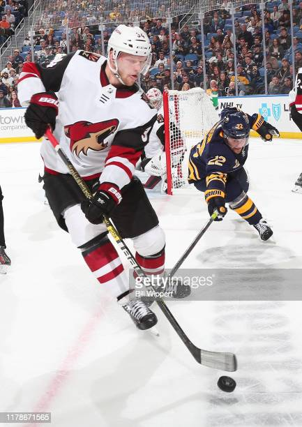 Carl Soderberg of the Arizona Coyotes is defended by Johan Larsson of the Buffalo Sabres during an NHL game on October 28 2019 at KeyBank Center in...