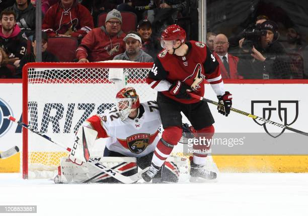 Carl Soderberg of the Arizona Coyotes looks for a loose puck as Sergei Bobrovsky of the Florida Panthers gets ready to make a save at Gila River...