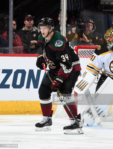 Carl Soderberg of the Arizona Coyotes looks for the puck against the Boston Bruins at Gila River Arena on October 05 2019 in Glendale Arizona