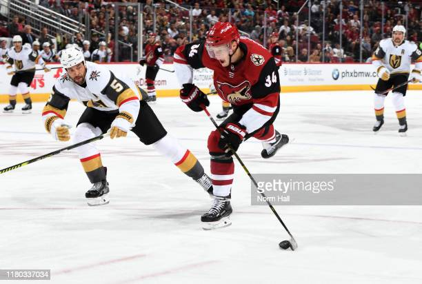 Carl Soderberg of the Arizona Coyotes shoots the puck as Deryk Engelland of the Vegas Golden Knights defends during the second period at Gila River...