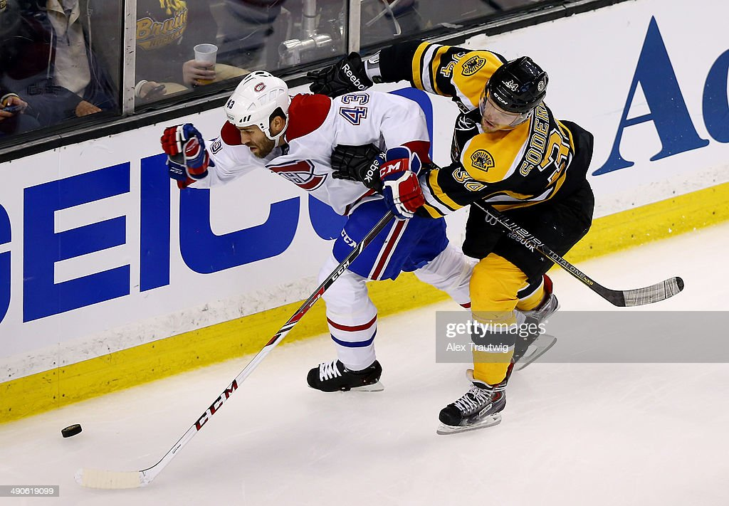 Carl Soderberg #34 of the Boston Bruins checks Mike Weaver #43 of the Montreal Canadiens during Game Seven of the Second Round of the 2014 NHL Stanley Cup Playoffs at the TD Garden on May 14, 2014 in Boston, Massachusetts.