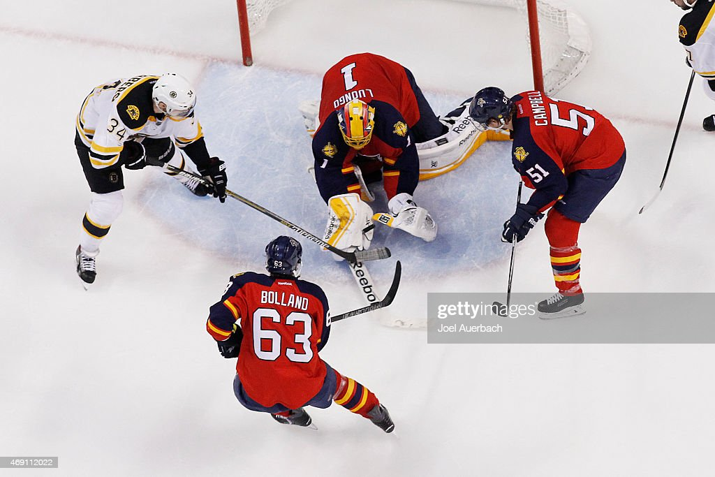 Carl Soderberg #34 of the Boston Bruins is unable to get his stick on the puck as Goaltender Roberto Luongo #1 of the Florida Panthers makes a save late in the third period at the BB&T Center on April 9, 2015 in Sunrise, Florida. The Panthers defeated the Bruins 4-2.