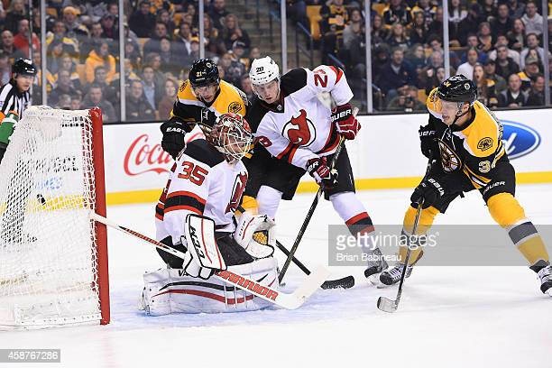 Carl Soderberg of the Boston Bruins scores a goal against Cory Schneider of the New Jersey Devils at the TD Garden on November 10 2014 in Boston...