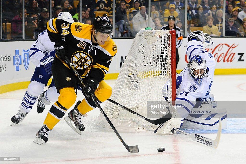 Carl Soderberg #34 of the Boston Bruins skates with the puck against James Reimer #34 of the Toronto Maple Leafs at the TD Garden on November 9, 2013 in Boston, Massachusetts.