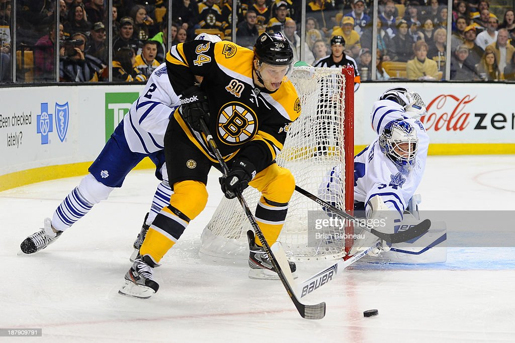 Carl Soderberg #34 of the Boston Bruins skates with the puck against goalie James Reimer #34 of the Toronto Maple Leafs at the TD Garden on November 9, 2013 in Boston, Massachusetts.