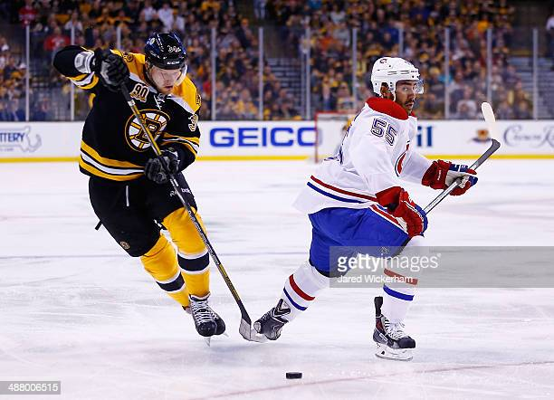 Carl Soderberg of the Boston Bruins skates with the puck around Francis Bouillon of the Montreal Canadiens in the first period in Game Two of the...