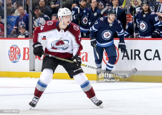 Carl Soderberg of the Colorado Avalanche and Adam Lowry of the Winnipeg Jets keep an eye on the play during third period action at the Bell MTS Place...
