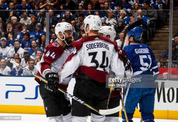Carl Soderberg of the Colorado Avalanche celebrates his goal with teammate Mark Barberio during the second period against the Toronto Maple Leafs at...