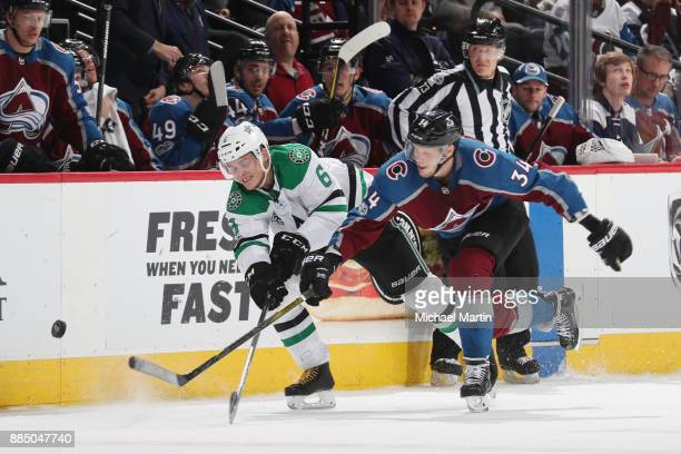 Carl Soderberg of the Colorado Avalanche fights for position against Julius Honka of the Dallas Stars at the Pepsi Center on December 3 2017 in...