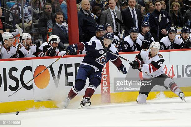 Carl Soderberg of the Colorado Avalanche gets spun around by Jiri Sekac of the Arizona Coyotes as he carries the puck across the center line during...