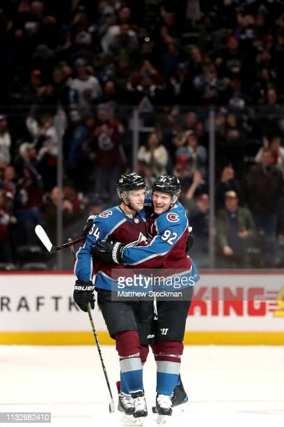 Carl Soderberg of the Colorado Avalanche is congratulated by Gabriel Landeskog after scoring the winning goal in a shoot out against the Vancouver...