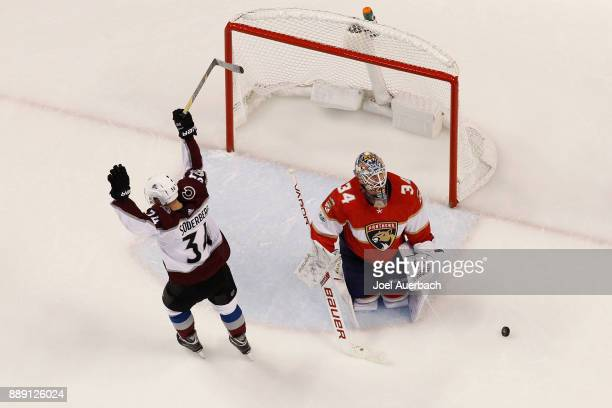Carl Soderberg of the Colorado Avalanche raises his stick after scoring a third period goal against goaltender James Reimer of the Florida Panthers...
