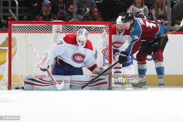 Carl Soderberg of the Colorado Avalanche scores a goal against goaltender Antti Niemi of the Montreal Canadiens at the Pepsi Center on February 14...