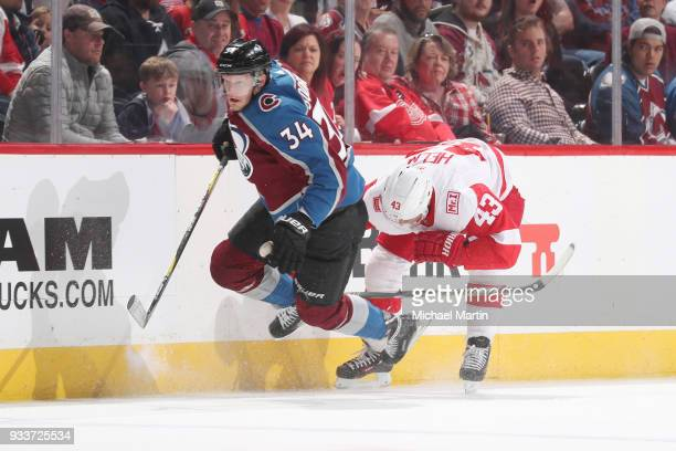 Carl Soderberg of the Colorado Avalanche skates against Darren Helm of the Detroit Red Wings at the Pepsi Center on March 18 2018 in Denver Colorado