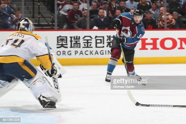 Carl Soderberg of the Colorado Avalanche takes a shot against goaltender Juuse Saros of the Nashville Predators in Game Three of the Western...