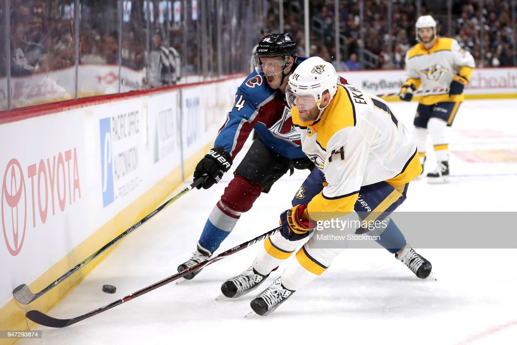 Carl Soderberg #34 of the Colorado Rockies fights for control of the puck against Mattias Ekholm #14 of the Nashville Predators in Game Three of the Western Conference First Round during the 2018 NHL Stanley Cup Playoffs at the Pepsi Center on April 16, 2018 in Denver, Colorado.