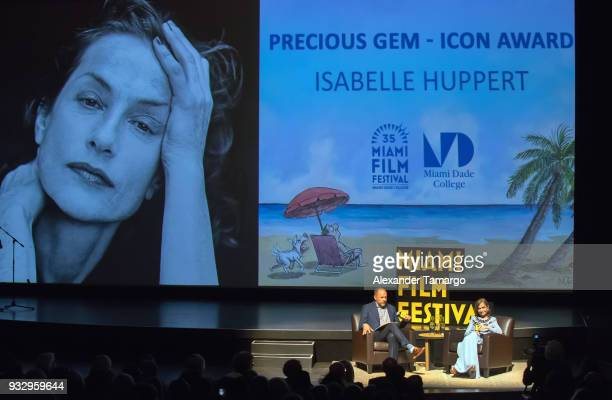 Carl Spence and Isabelle Huppert are seen at the Miami Film Festival 2018 at the Olympia Theatre on March 16 2018 in Miami Florida