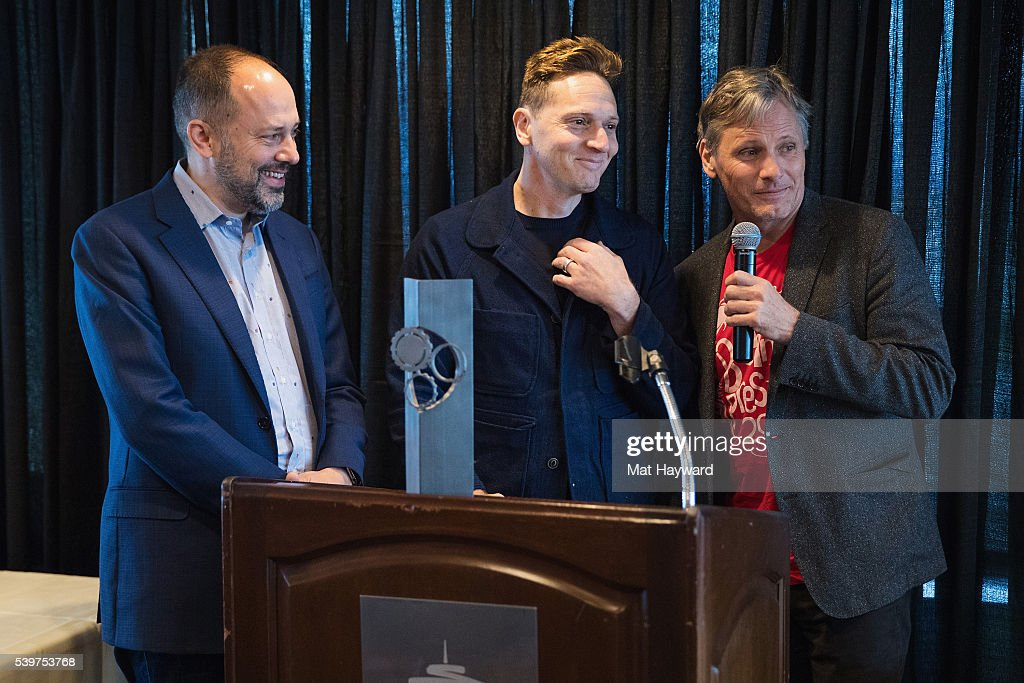 Carl Spence, Matt Ross and Viggo Mortensen speak after Matt is presented with the award for best film 'Captain Fantastic' during the SIFF Golden Space Needle Award ceremony on June 12, 2016 in Seattle, Washington.