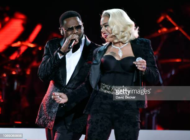 Carl Thomas and Faith Evans perform during the 2018 Soul Train Awards at the Orleans Arena on November 17 2018 in Las Vegas Nevada