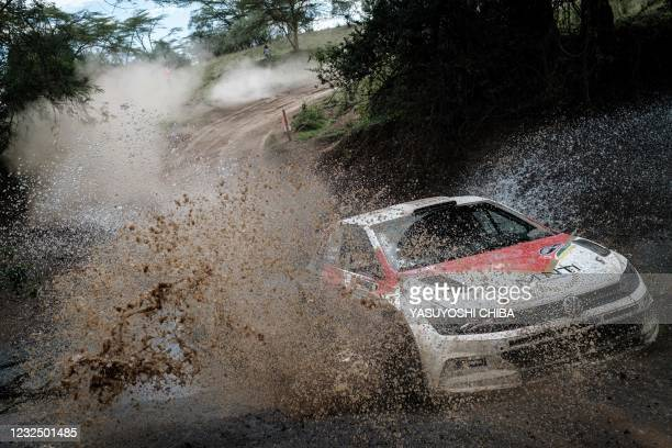 Carl Tundo of Kenya and his co-driver Tim Jessop of Kenya drive over a stream during the African Rally Championship Equator Rally Kenya at Soysambu...